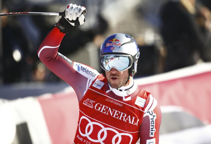 Norway's Aksel Lund Svindal celebrates as he gets to the finish area, during an alpine ski, men's World Cup super-G, in Kitzbuehel, Austria, Friday, Jan. 22, 2016. (AP Photo/Giovanni Auletta)