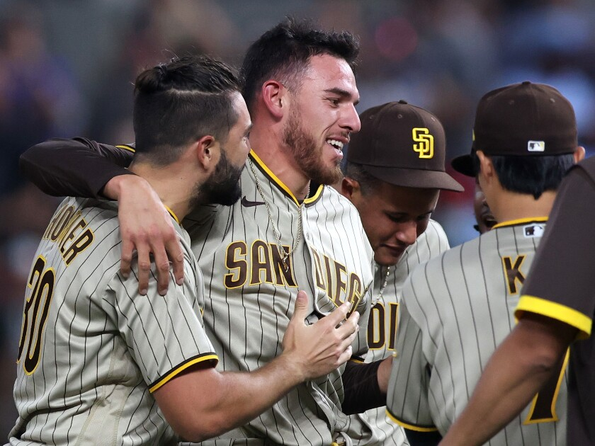 Joe Musgrove celebrates with teammates after pitching a no-hitter against the Texas Rangers.