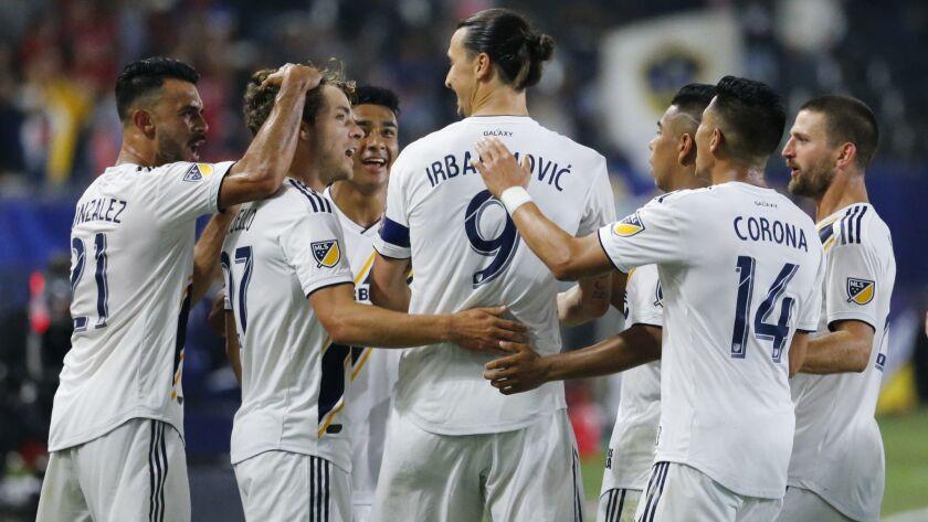 LA Galaxy forward Zlatan Ibrahimovic (9) of Sweden, celebrates his goal with teammates against Toron