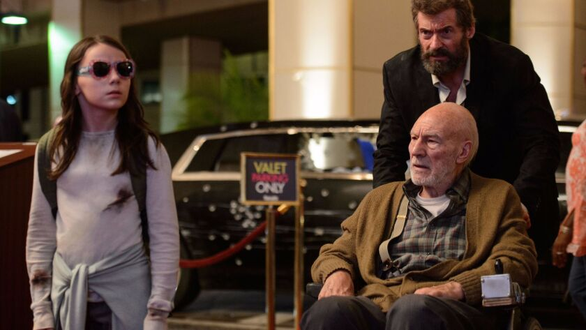 "Dafne Keen, left, Patrick Stewart and Hugh Jackman in ""Logan."""