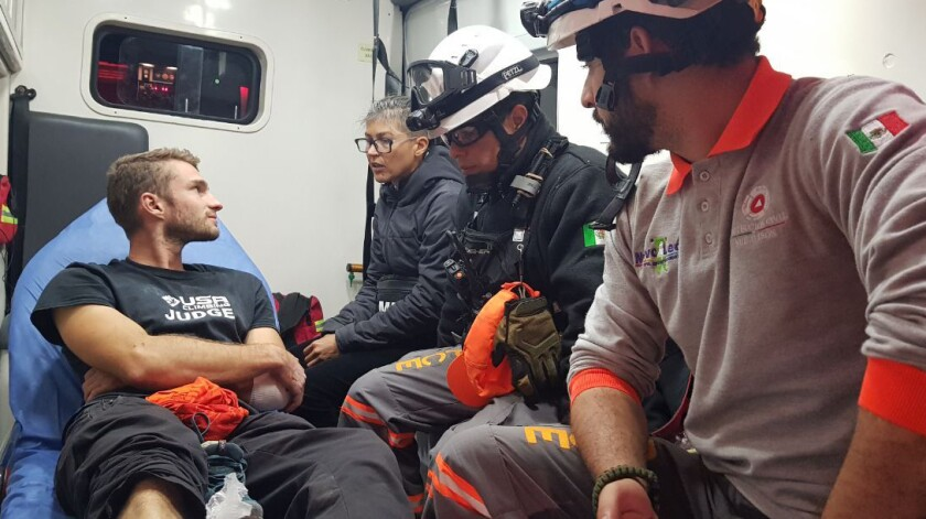 Aidan Jacobson sits inside an ambulance