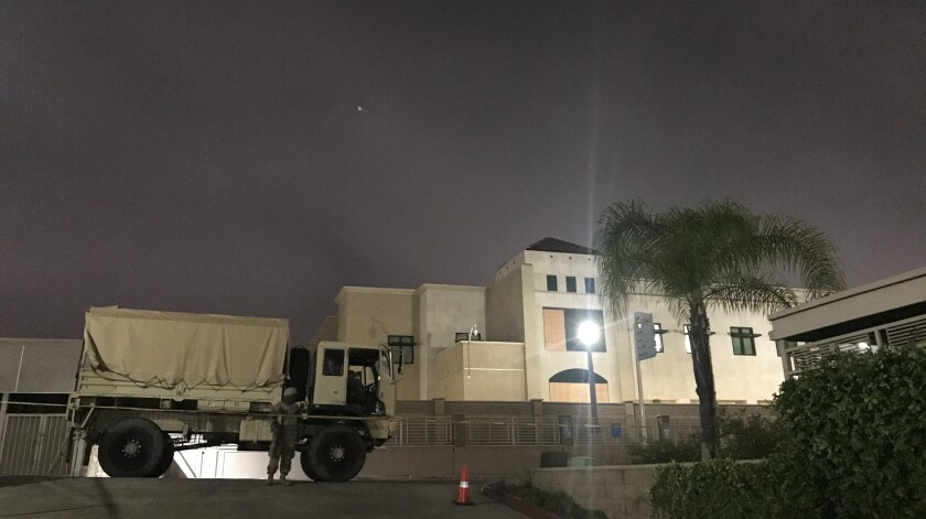 A California National Guard member stands outside the La Mesa Police Department on Wednesday night
