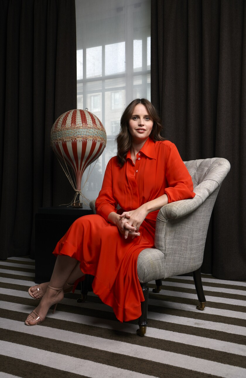 """It's just ropes and canvas, but the stakes are very high,"" Felicity Jones says of hot-air ballooning, depicted in ""The Aeronauts."" She sits next to a model balloon at a press event in London."