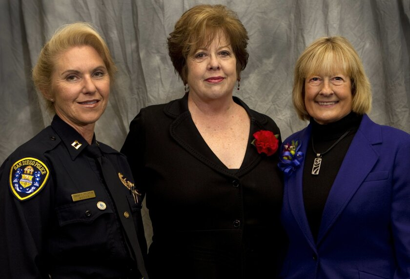 San Diego police Capt. Sarah Creighton, former FBI agent Natalie Gore and ARJIS executive director Pam Scanlon are honored during the second annual Women in Blue luncheon.