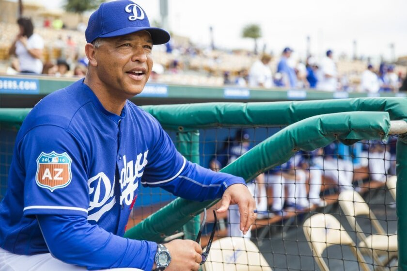 Dodgers Manager Dave Roberts looks on from the dugout during a spring training game against the Chicago White Sox on March 3.