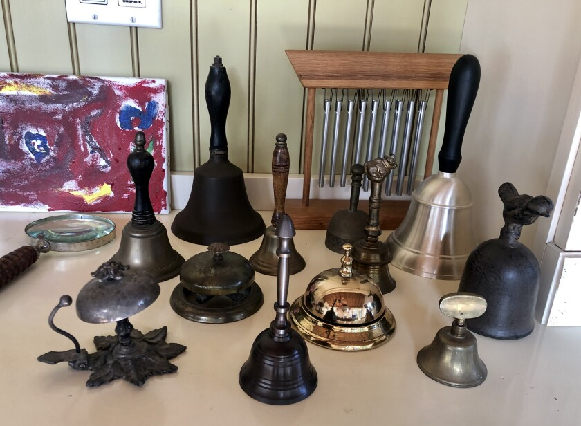 Johanna Isaacs, whose bell collection is pictured, hopes others will join her in ringing a bell at 6 p.m. Christmas Eve.
