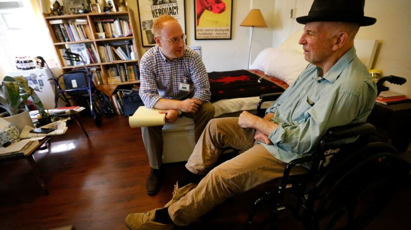 Lewis MacAdams, right, the 'Grand Old Man' of the Los Angeles River, visits at his home in the Kingsley Manor retirement community with historian Michael Block, who records his every word as they plunge into work on an autobiography.