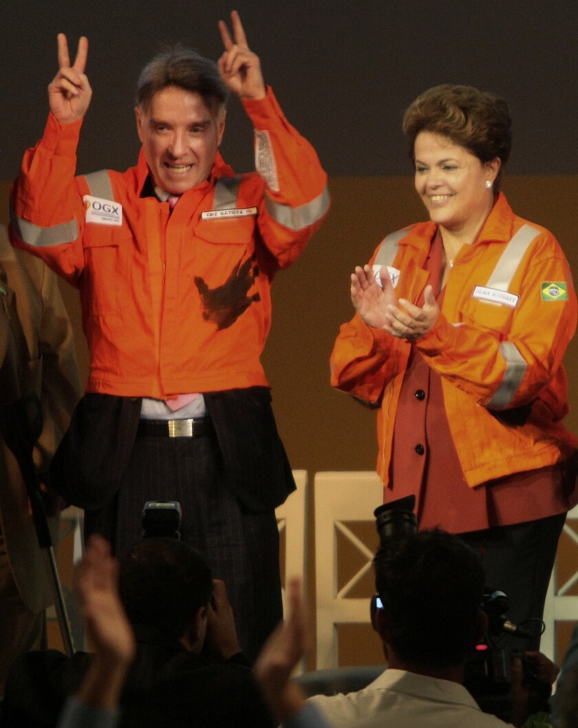 Eike Batista, shown with President Dilma Rousseff, has embodied the optimism and riches of the nation's oil boom, but his firms' stock prices are plunging.