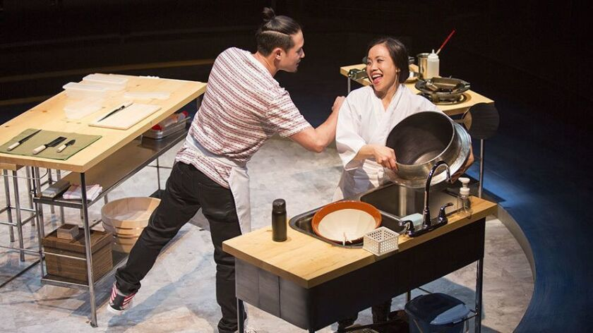 "Raymond Lee and Tina Chilip in the Old Globe's 2016 production of ""tokyo fish story."""