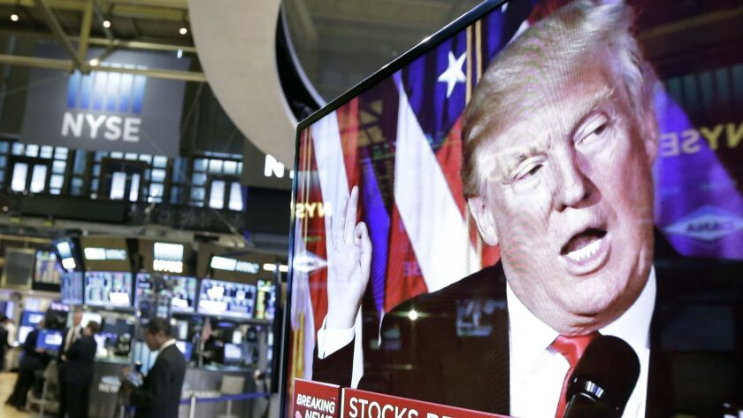 An image of Donald Trump appears on a television screen on the floor of the New York Stock Exchange on Nov. 9, 2016.