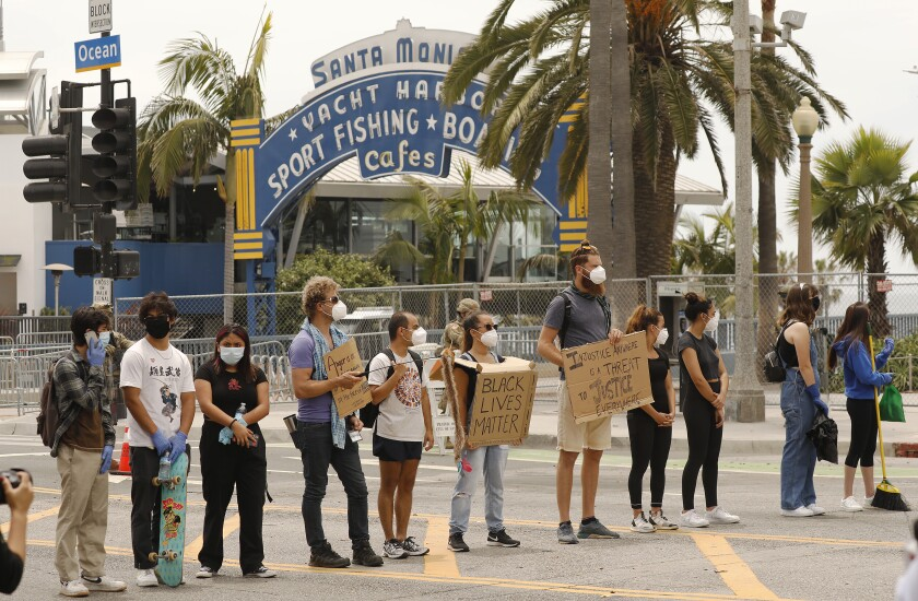Protesters stand near Santa Monica Pier in June, after the deaths of Breonna Taylor, Ahmaud Arbery and George Floyd.