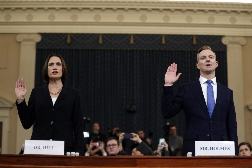 Fiona Hill and David Homes sworn in to testify