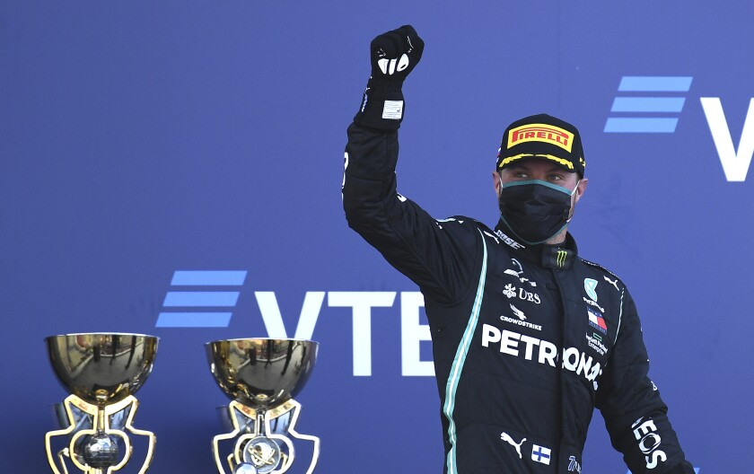 Valtteri Bottas celebrates on the podium.