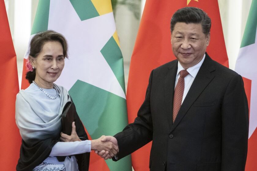 FILE - In this April 24, 2019, file photo, Chinese President Xi Jinping, right, shakes hands with Myanmar State Counsellor Aung San Suu Kyi at the Great Hall of the People in Beijing. The military coup on Monday, Feb. 1, 2021 deposed national leader Aung San Suu Kyi a little over a year after Chinese President Xi Jinping made a show of support to her with the first visit by a head of state from Beijing to Myanmar since 2001 and 33 agreements on a wide range of issues. (Fred Dufour/Pool Photo via AP, File)