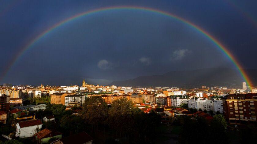 A rainbow over Naranco mount, northern Spain, Oviedo - 27 Oct 2018