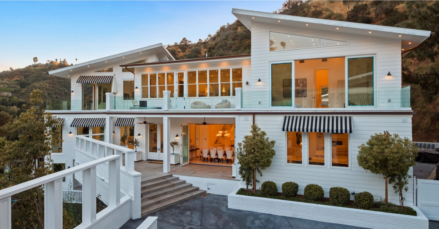 Sprawling across the foothills of the Santa Monica Mountains, the two-acre estate holds a 13,000-square-foot home, a guesthouse and a 70-foot swimming pool.