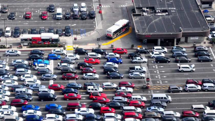 A bird-s eye view of the Avis rental car area at Los Angeles International Airport.