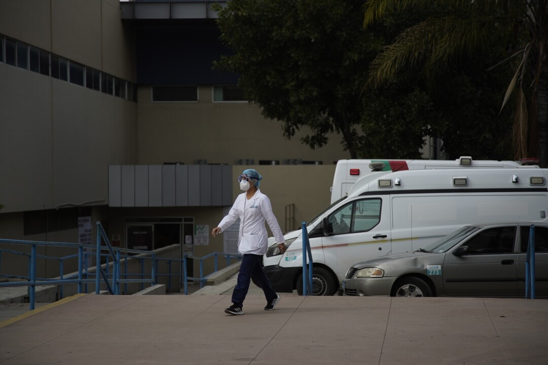 Healthcare workers walk outside of Hospital General Numero 1 in Tijuana, Mexico on April 17, 2020. Between Tuesday and Wednesday, Baja California health officials documented 123 new confirmed coronavirus cases, bringing the tally to 975