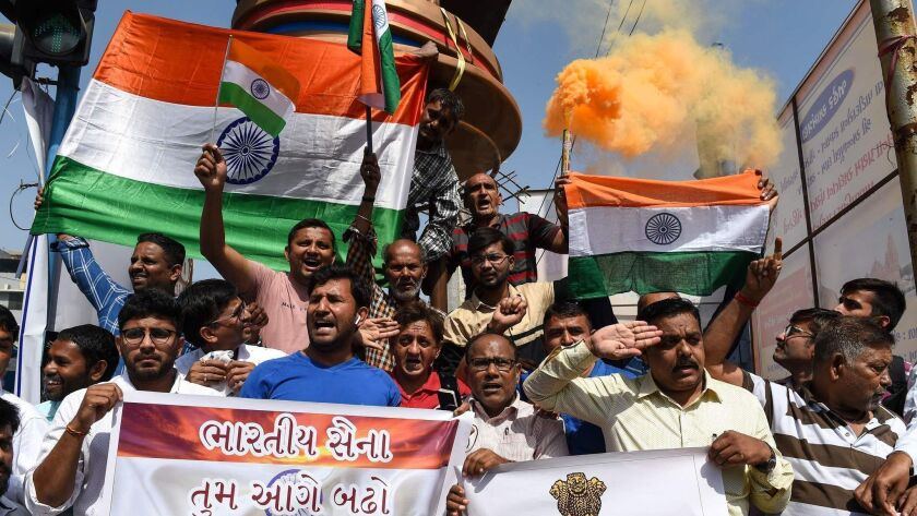 Residents in Ahmedabad, India, demonstrate in support of the military on Feb. 26, 2019, after an airstrike on what India said was a terrorist training camp in Pakistan.