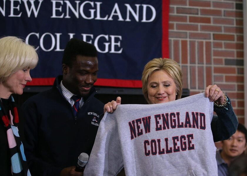 Former secretary of State Hillary Clinton receives a sweatshirt during a student town hall meeting at New England College Saturday in Henniker, N.H.