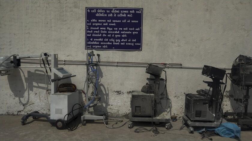Damaged hospital equipment outside a hospital.