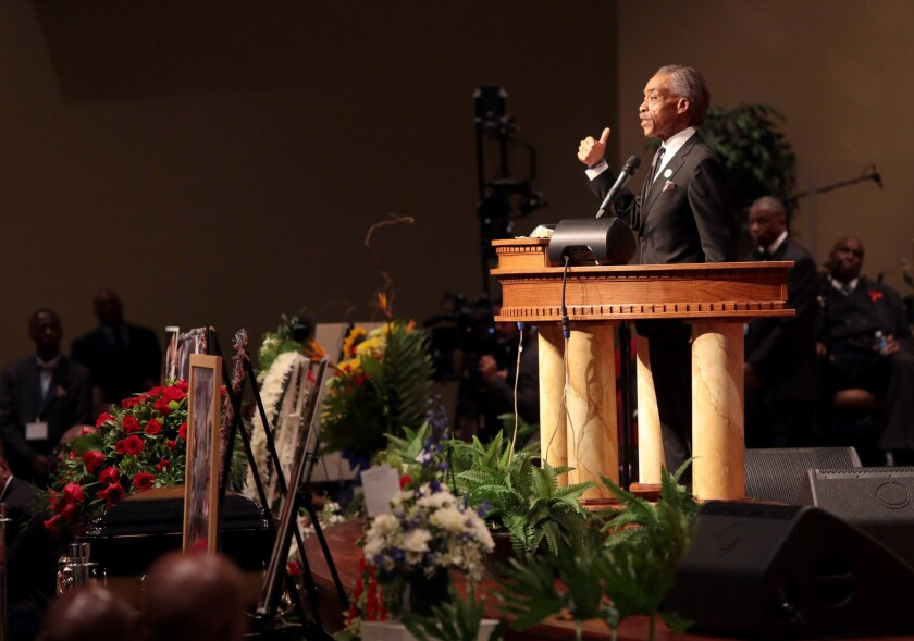 The Rev. Al Sharpton speaks during the funeral of slain young black man Michael Brown inside Friendly Temple Missionary Baptist Church in St. Louis on Monday.