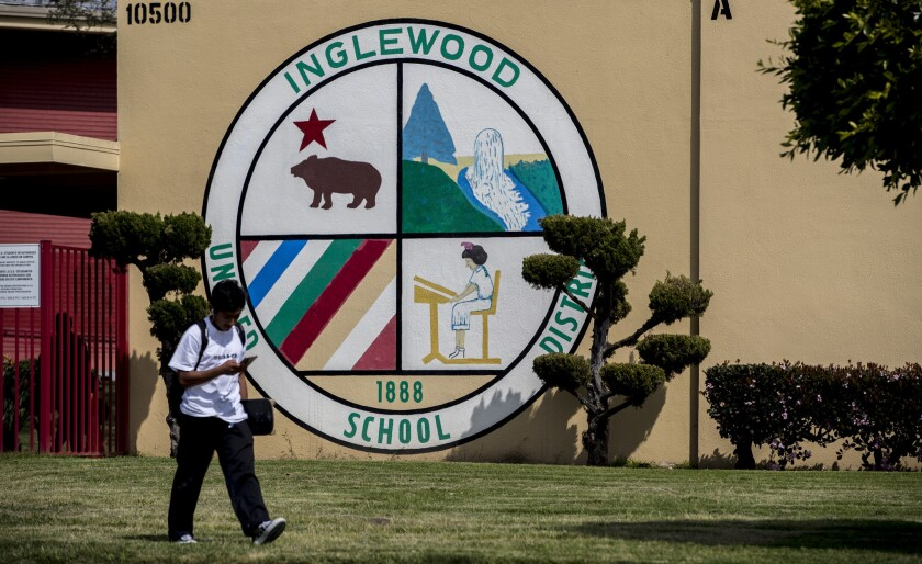 A student leaves an Inglewood Unified School District campus on April 5.