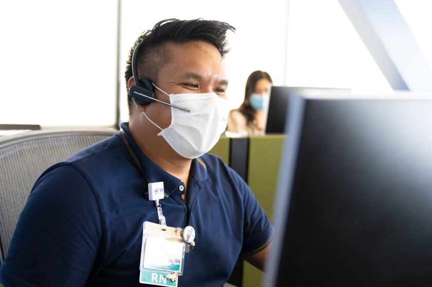 Joe Bautista, a nurse with UCSD Health, checks on coronavirus patients daily by telephone.