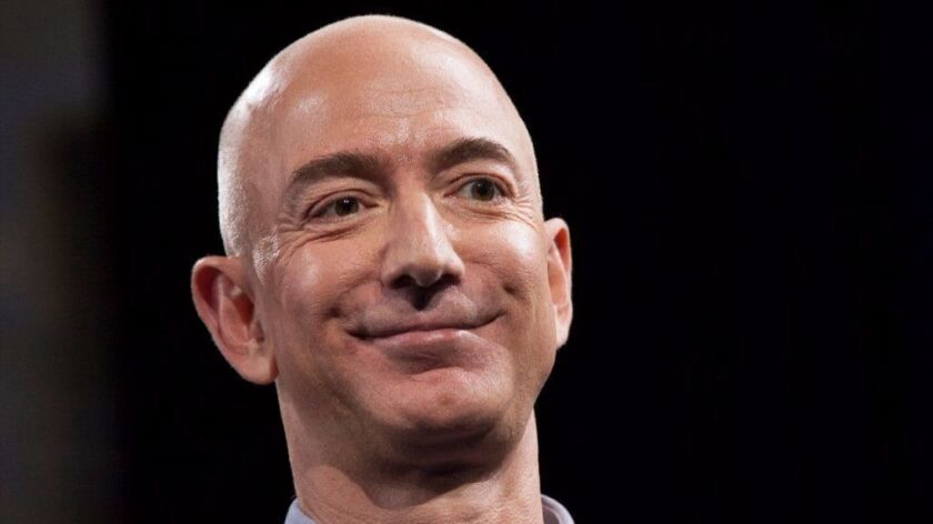 Amazon.com chief Jeff Bezos has paid $12.9 million for the house next door to his Beverly Hills estate.