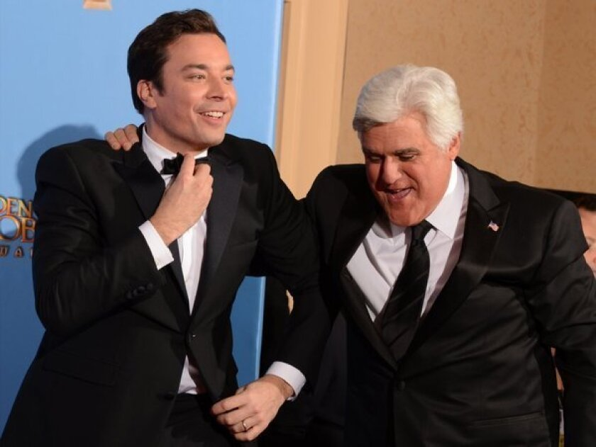 "NBC announced that Jimmy Fallon would take over ""The Tonight Show"" in early 2014. Comedians Jimmy Fallon, left, and ""Tonight Show"" host Jay Leno are pictured at the Golden Globes awards show in January."