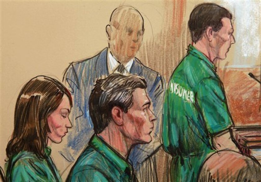 FILE - In this July 1, 2010, file artist rendering three northern Virginia residents, accused spies for Russia, from left, Patricia Mills, Michael Zottoli, and Mikhail Semenko, standing, appear in federal court in Alexandria, Va. A scheduled court hearing for three suspects in the Russia spy case was postponed Wednesday, a defense lawyer for one of them said, amid speculation that the U.S. and Russia are arranging a spy swap. (AP Photo/Dana Verkouteren, File)