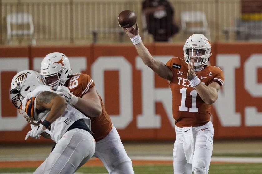 Texas' Sam Ehlinger (11) throws a pass against UTEP during the first half of an NCAA college football game in Austin, Texas, Saturday, Sept. 12, 2020. (AP Photo/Chuck Burton)
