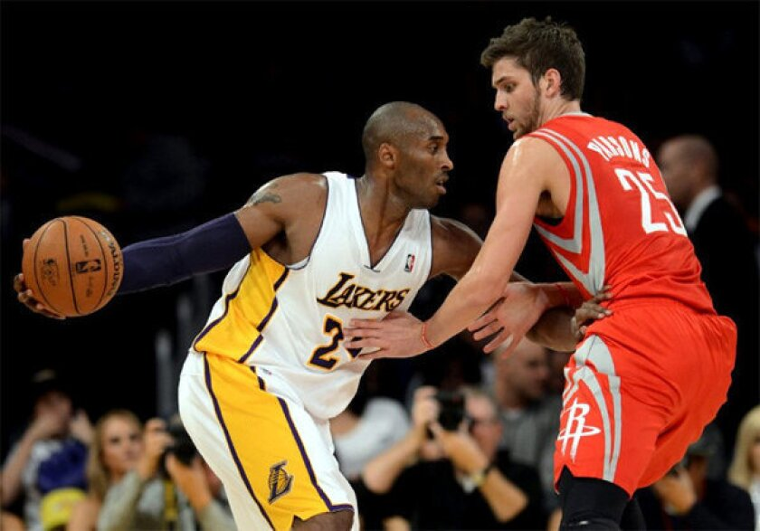 Kobe Bryant racked up 22 points, 11 rebounds and 11 assists against the Rockets on Sunday at Staples Center.