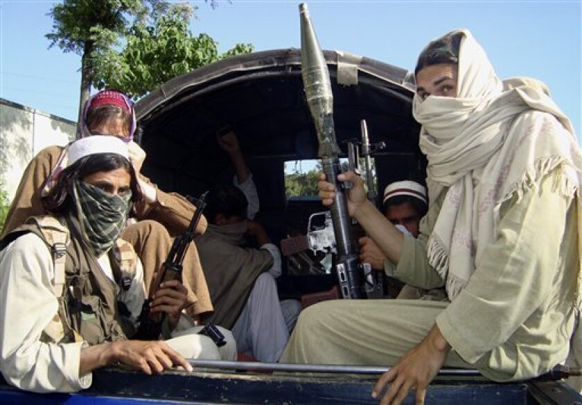 FILE - In this April 24, 2009 picture, Pakistani Taliban leave Buner, Pakistan. Coordinated attacks - along with threats to women, shops selling CDs and barbers - suggest that the Taliban are bleeding out of their traditional havens in the Northwest Frontier Province into Pakistan's Punjab heartland, home to more than half of the country's 180 million people. (AP Photo/Naveed Ali, File)