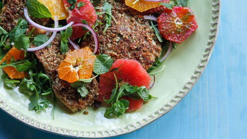 Pepita-Crusted Sea Bass With Coconut Chili Oil prepared by Isabel Cruz of Isabel's Cantina in Pacific Beach.