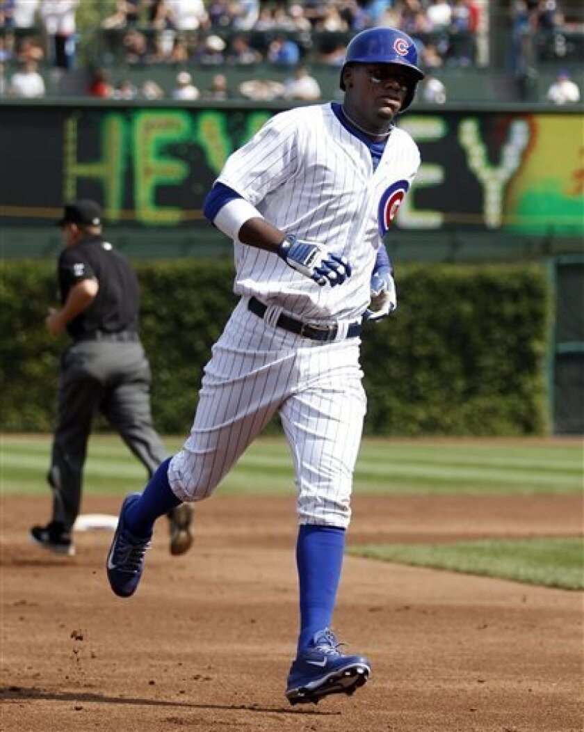 Chicago Cubs' Junior Lake rounds the bases after hitting a home run against the Milwaukee Brewers during the first inning of a baseball game on Friday, Sept. 6, 2013, in Chicago. (AP Photo/Andrew A. Nelles)