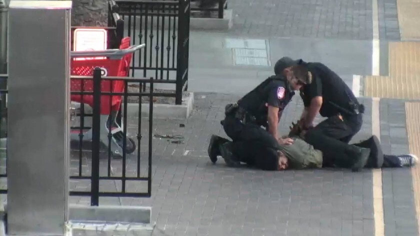 A Metropolitan Transit System officer puts his knee on a man's back and neck for several minutes in 2019.