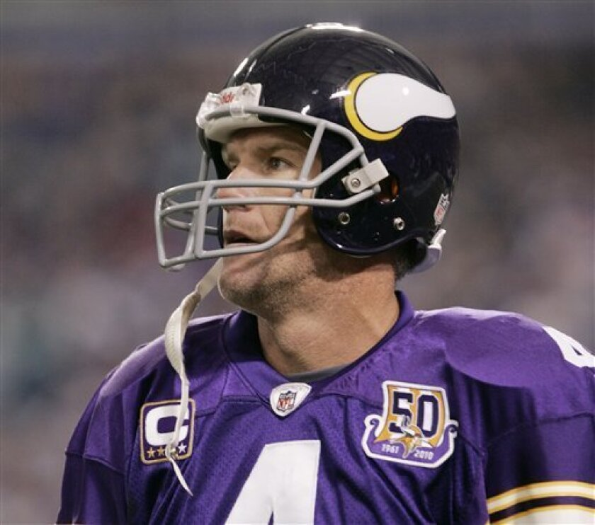 FILE - In this Sept. 19, 2010, file photo, Minnesota Vikings quarterback Brett Favre walks to the sideline after throwing an interception against the Miami Dolphins during an NFL football game in Minneapolis. The NFL says it is reviewing allegations involving the Vikings' Brett Favre, who the website Deadspin says sent racy messages and photos to a former sideline reporter while he played for the New York Jets. (AP Photo/Andy Blenkush, File)