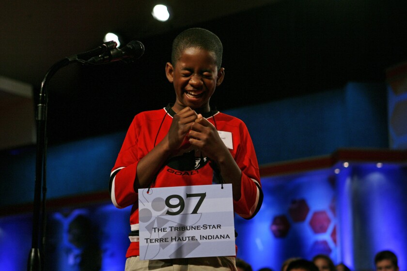 """Kennyi Aouad, 11, of Terre Haute, Ind., bursts into laughter when asked to spell the word """"sardoodledom"""" in Round 3 of the 2007 Scripps National Spelling Bee in Washington. This year a vocabulary test has been added to the competition."""