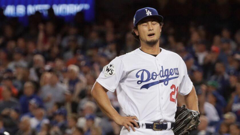 LOS ANGELES, CA, WEDNESDAY, NOVEMBER 1, 2017 - Yu Darvish recoils as Astros centerfielder hits a thr