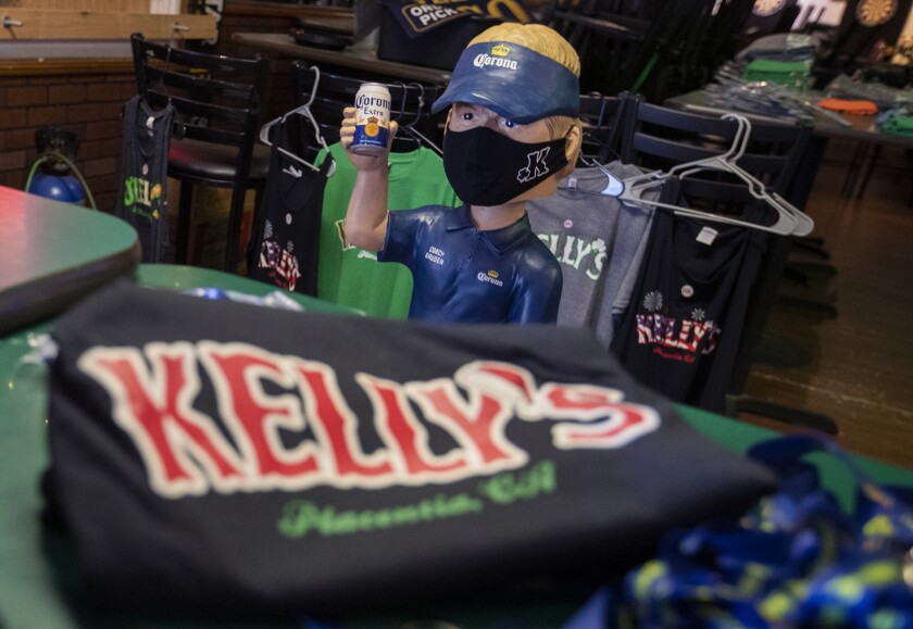 T-shirts and other items on sale at Kelly's Korner Tavern.