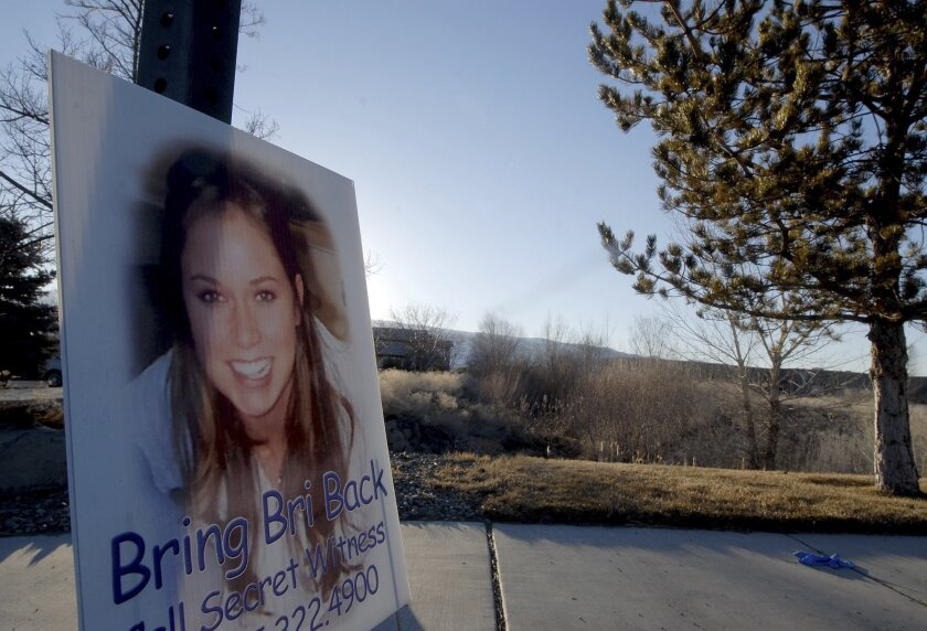 FILE  - In this Friday, Feb. 15, 2008 file photo, a sign with a photograph showing missing college student Brianna Denison, is displayed near a field where the body of a woman was found in Reno, Nev. A lawyer for a Nevada man sentenced to death for the 2008 kidnapping and killing of Brianna Denison