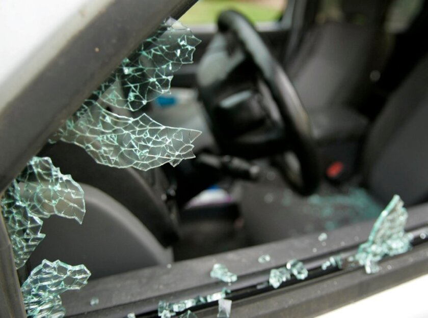 One of at least 22 vehicles that had their windows smashed and items in the vehicles stolen, along the street and at the businesses in the 9900 block of Hibert Street in Scripps Ranch