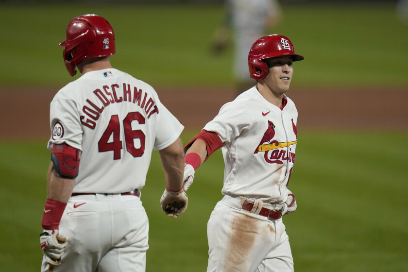 St. Louis Cardinals' Tommy Edman, right, is congratulated by teammate Paul Goldschmidt (46).