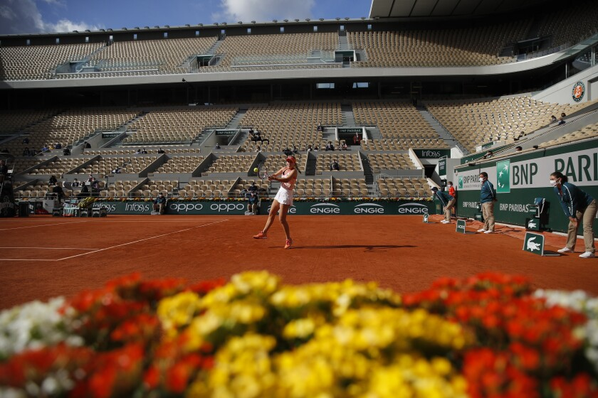 Sofia Kenin of the U.S. plays a shot against Danielle Collins of the U.S. in the quarterfinal match of the French Open tennis tournament on center court Philippe Chatrier at the Roland Garros stadium in Paris, France, Wednesday, Oct. 7, 2020. (AP Photo/Christophe Ena)
