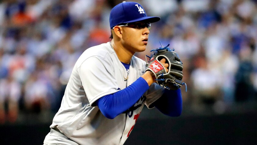 Julio Urias works from the stretch during a start against the Mets on May 27.