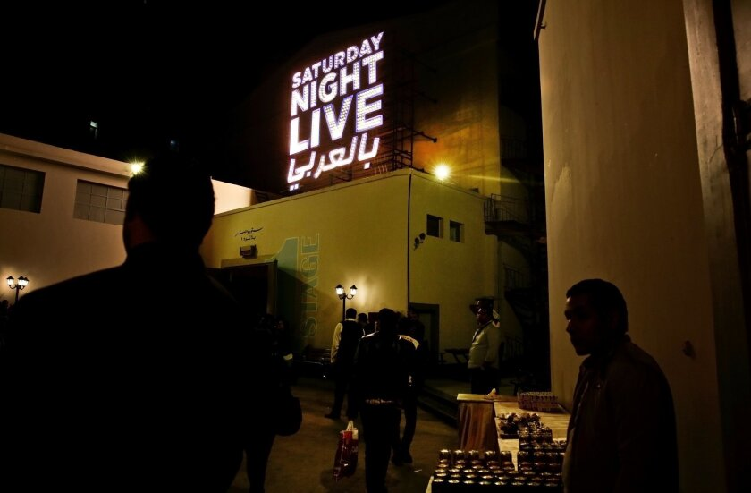 """In this Tuesday, Feb. 16, 2016 photo, people wait for this first """"Saturday Night Live Arabia,"""" show to start in Cairo, Egypt. Saturday Night Live is coming this Saturday to the Middle East 'in Arabic' with fresh material written for the region's cultures and sense of humor. (AP Photo/Nariman El-Mof"""