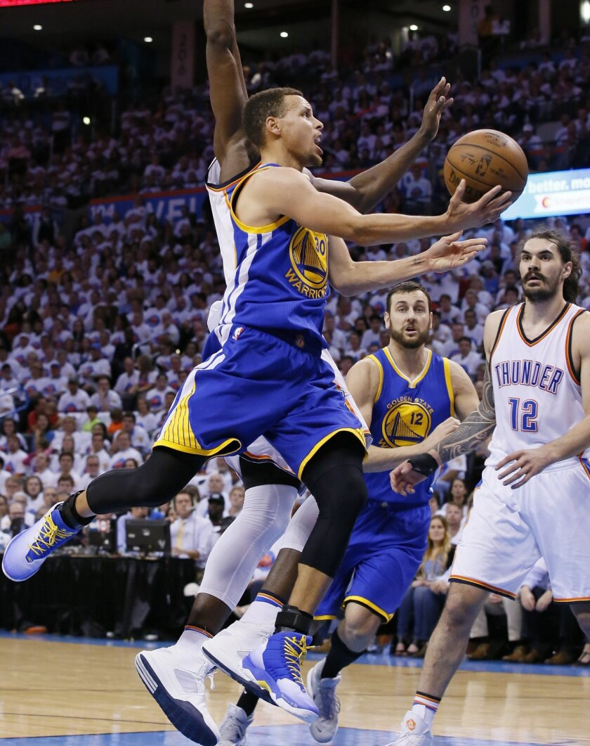 Golden State Warriors guard Stephen Curry, front, shoots in front of Oklahoma City Thunder forward Serge Ibaka, left, and center Steven Adams (12) during the first half in Game 4 of the NBA basketball Western Conference finals in Oklahoma City, Tuesday, May 24,, 2016. The Thunder won 118-94. (AP Ph