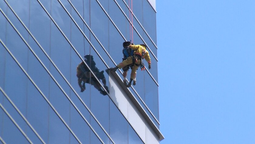 Two window washers had to be rescued Monday