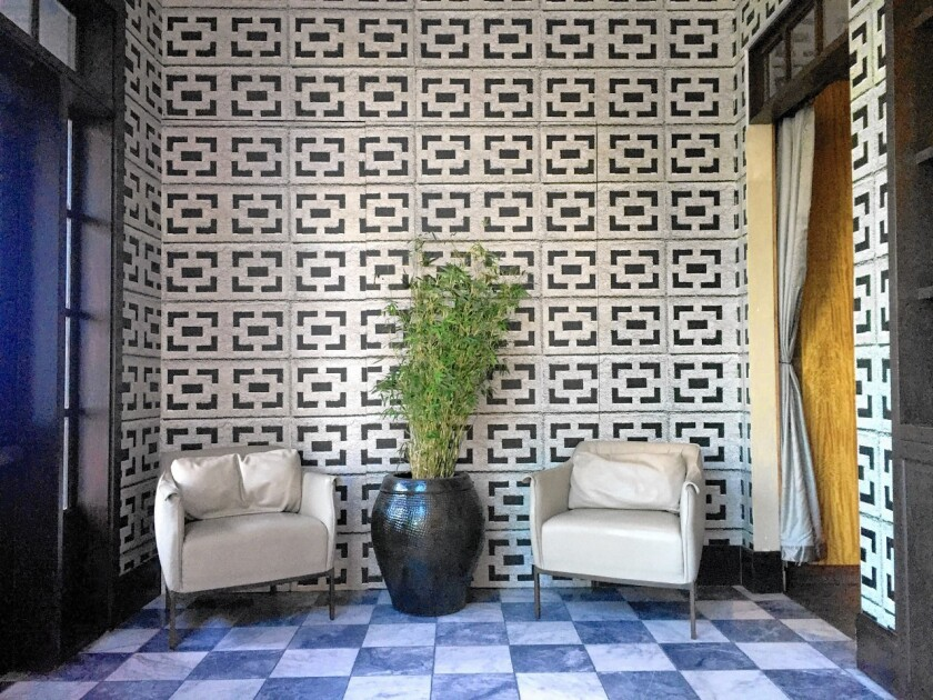 Roku restaurant on the Sunset Strip has wallpaper printed with a rectangular concrete block motif.